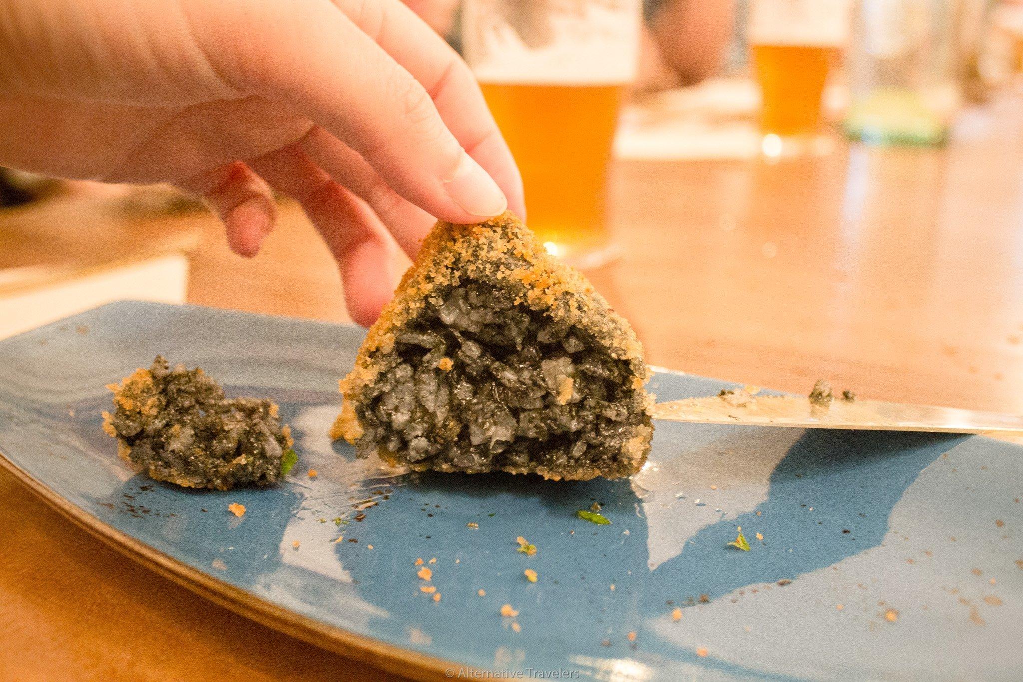 Close up of Arancinis de la Nonna at La Tia Carlota, a vegan gastrobar in Madrid, Spain | AlternativeTravelers.com